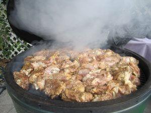 U.R.A. Jerk treated meat in a grill